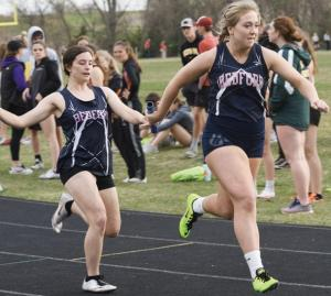Bedford-Girls-Track-Carmen-Perdew-taking-baton