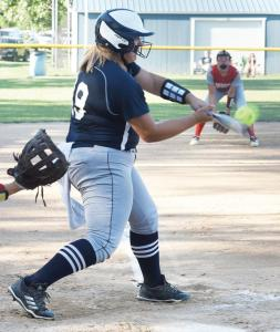 sb-emily-hitting-the-ball-Recovered