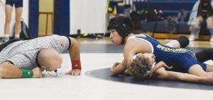 wrestling-gomez-pin-i35-and-looking-at-coach
