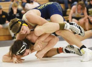 wrestling-jake-cox-tying-up-opponent-for-pin
